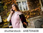 pretty young woman with mobile... | Shutterstock . vector #648704608