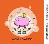 two hands holding piggy bank...   Shutterstock .eps vector #648729010