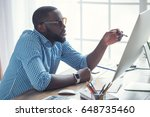 young african man working in...   Shutterstock . vector #648735460