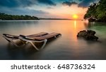 sunset with beach chairs on a... | Shutterstock . vector #648736324
