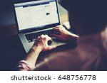 cropped shot of a man's hands... | Shutterstock . vector #648756778