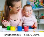 mom and daughter paint on... | Shutterstock . vector #648772096