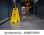 wet floor caution sign. | Shutterstock . vector #648819004