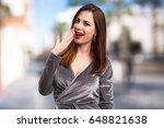 beautiful young girl making... | Shutterstock . vector #648821638