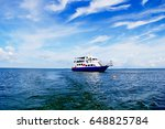 boat on the ocean under the... | Shutterstock . vector #648825784