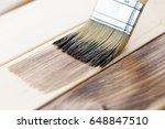 applying wood stain on wooden... | Shutterstock . vector #648847510