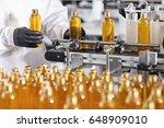 plastic bottles with yellow... | Shutterstock . vector #648909010