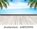 wooden floor and beautiful sea... | Shutterstock . vector #648929494