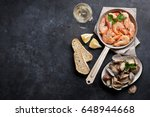 fresh seafood and white wine on ... | Shutterstock . vector #648944668