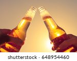 two people enjoying a cold beer ... | Shutterstock . vector #648954460
