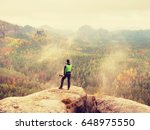 man takes photos with smart... | Shutterstock . vector #648975550