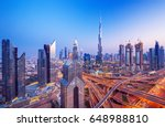 dubai skyline at sunset with... | Shutterstock . vector #648988810