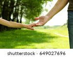 the parent holds the hand of a... | Shutterstock . vector #649027696