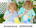 two little boys making... | Shutterstock . vector #649042468