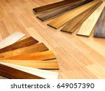 new planks of oak parquet of... | Shutterstock . vector #649057390