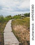 wooden boardwalk in cloudy day   Shutterstock . vector #649058380