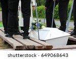 pallbearers putting down the... | Shutterstock . vector #649068643