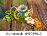 tea pot of herbal tea on a... | Shutterstock . vector #649089010
