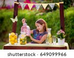 young girl standing at her... | Shutterstock . vector #649099966