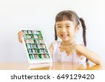 asian girl pointing to her... | Shutterstock . vector #649129420