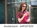 Girl With Sunglasses Using...