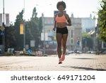 fitness model running outside... | Shutterstock . vector #649171204