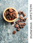 sweet dried raisins in bowl on... | Shutterstock . vector #649175194