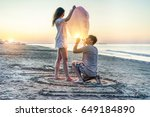 young couple of lovers lighting ... | Shutterstock . vector #649184890