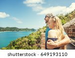 a young couple of travelers are ... | Shutterstock . vector #649193110