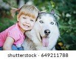cute little girl hugging a... | Shutterstock . vector #649211788