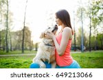 woman hugging dog on lawn | Shutterstock . vector #649213066