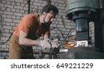 man blacksmith in workshop... | Shutterstock . vector #649221229