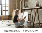 woman painter sitting on the... | Shutterstock . vector #649227229