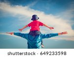 happy father and son playing on ... | Shutterstock . vector #649233598