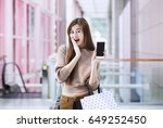 asian girls with shopping bags...   Shutterstock . vector #649252450