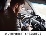 the man in the car reviews the... | Shutterstock . vector #649268578