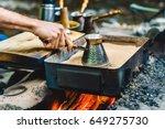 man is cooking turkish coffee... | Shutterstock . vector #649275730