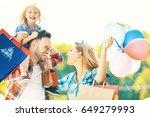 happy family walking along the... | Shutterstock . vector #649279993