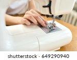 female tailor threading bobbin... | Shutterstock . vector #649290940