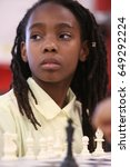 Small photo of NEW YORK CITY - MAY 26 2017: Brooklyn Police Athletic League & King's County DA's office sponsored an afterschool chess program for Bed-Stuy elementary students.