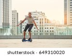 guy riding hoverboard  city...   Shutterstock . vector #649310020