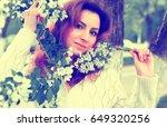 women in park branch tree flower | Shutterstock . vector #649320256