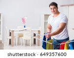 man doing laundry at home | Shutterstock . vector #649357600