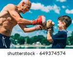 Small Boxer With Senior Traine...