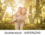 mother and daughter outdoors in ... | Shutterstock . vector #649396240