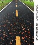 asphalt road in the park | Shutterstock . vector #649402408