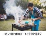 handsome man preparing barbecue | Shutterstock . vector #649404850