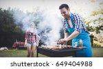 handsome man preparing barbecue | Shutterstock . vector #649404988