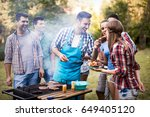 friends enjoying bbq party | Shutterstock . vector #649405120