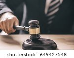 gavel in the hand of a man in a ... | Shutterstock . vector #649427548